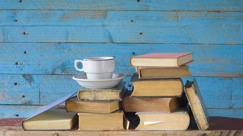 Mug on pile of books