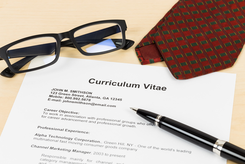 Glasses, CV, pen and tie