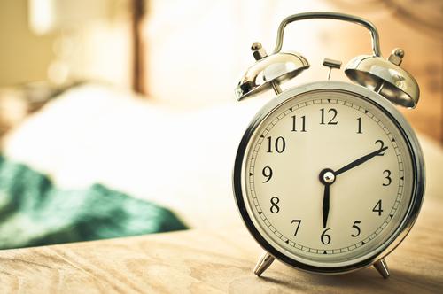 alarm clock on bedside table