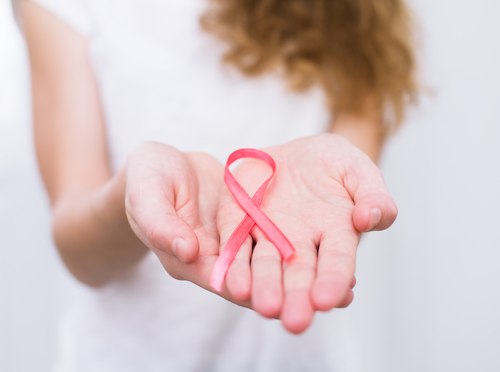 girl holding breast cancer awareness ribbon
