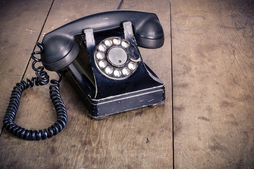 old telephone on wooden floor