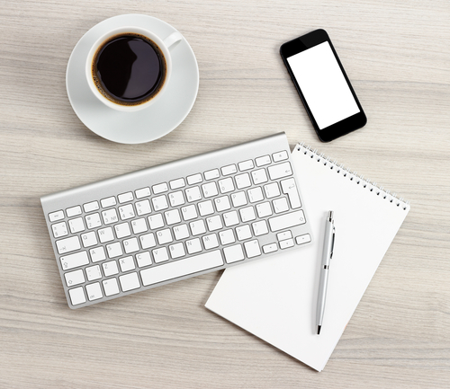 coffee, keyboard, notepad and pen, phone