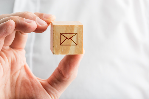 wooden block with e-mail symbol