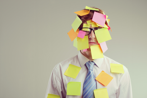 Man covered in post-it notes