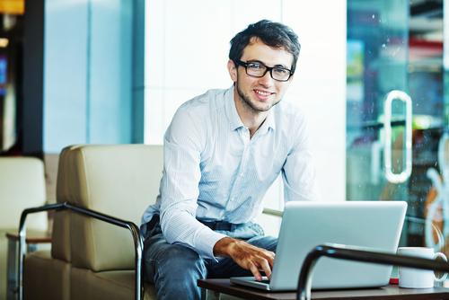 Recruitment Graduate at his laptop