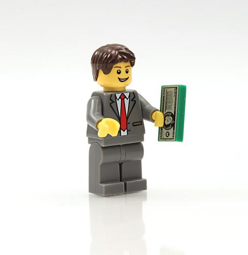 Lego man holding money