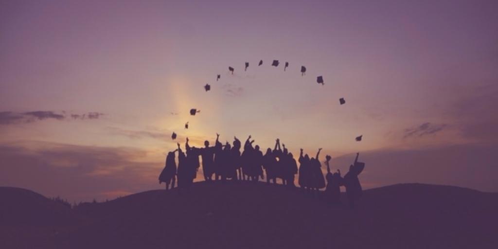 Recent graduates celebrating their graduation